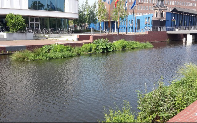 Drijvende tuinen in waterboulevard