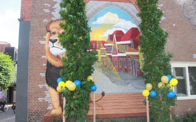 Muurschildering op wand van de muur op de hoek van de Grotestraat/Schalderoi